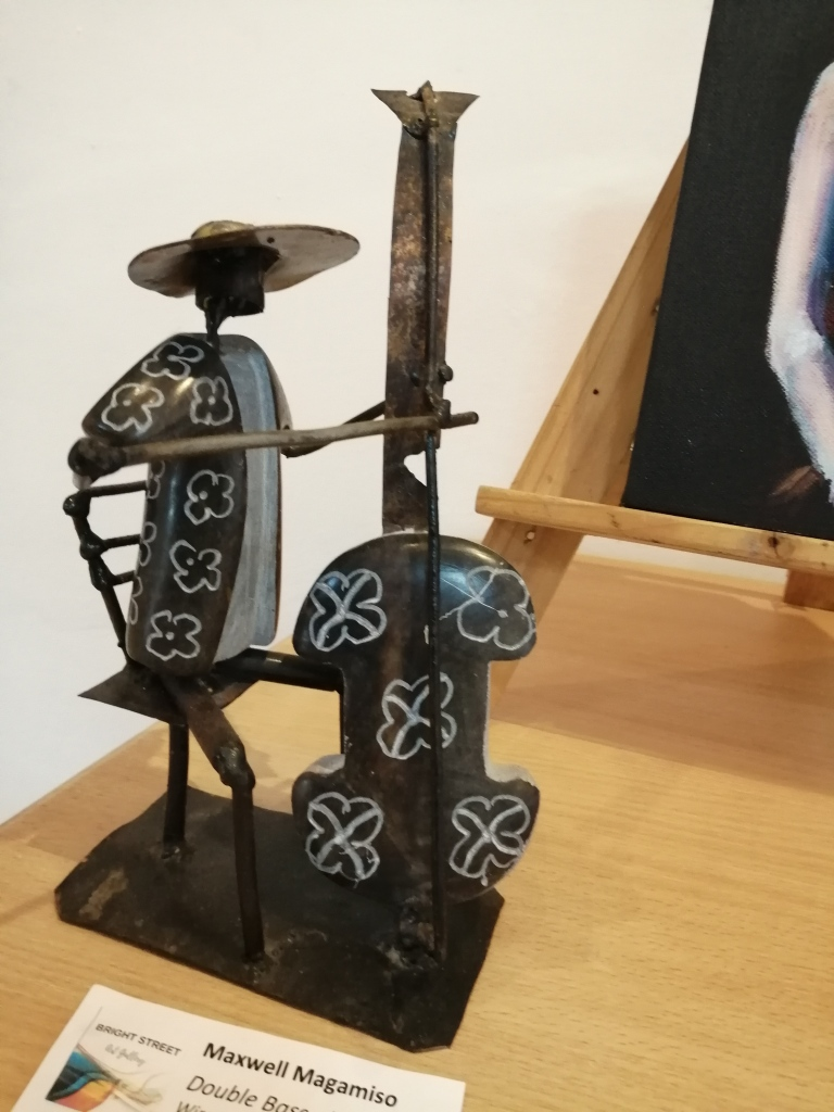 """""""Double bass player"""" by Maxwell Magumise, wire and stone sculpture, R595.00"""