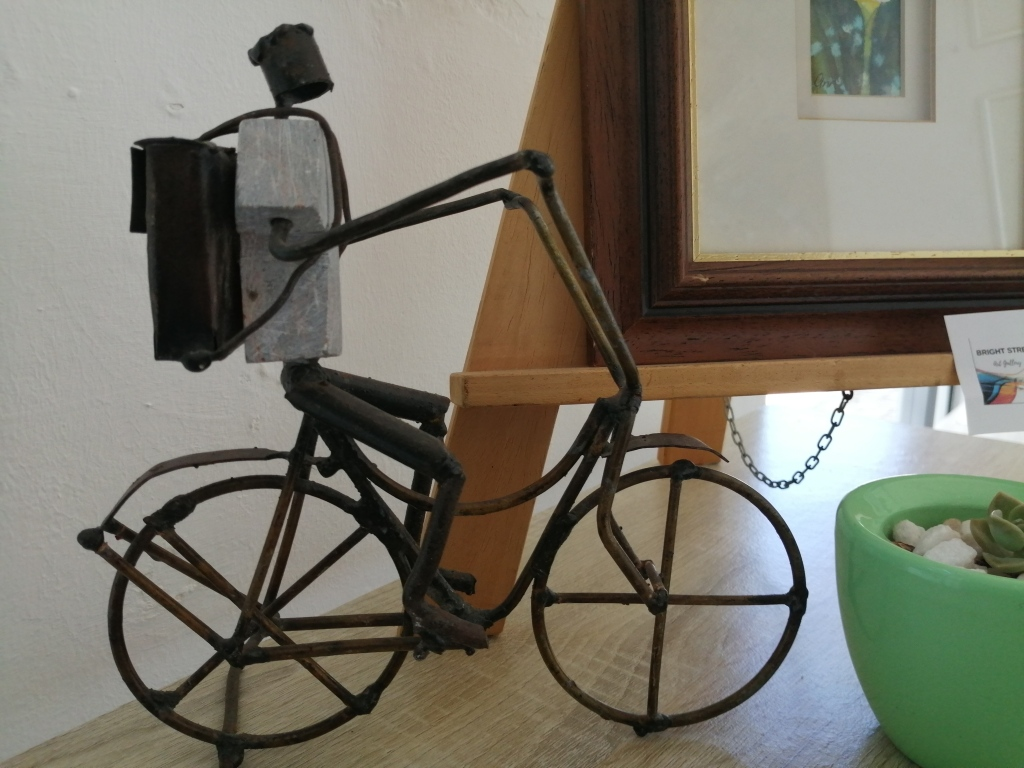 """""""Bike Rider"""" by Maxwell Magumise, wire and stone sculpture, R595.00"""